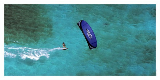 Kitesurf - Tobago Caies - GrenadinesProduct: in house made quality print on 8 ultrachome colors Epson ink Jet printer.Available sizes: . 50 x 100 cm. 100 x 200 cmAvailable papers: . Standard 250 gr glossy paper print, black streak, white margin, no signature. Top quality glossy 290 gr. paper, black streak, white margin, checked and signed by the author. Fine Art print (signed, numbered, stamped, registered) on demand. Other supports (Canvas, Acrylic, Metal) on demandPackaging: cylindric reinforced tubeShipping options: regular mail or Shipping companyClick on the basket icon to select your options and start the online ordering process