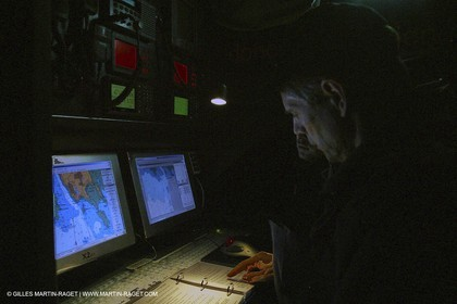 Lorient -Orange II - First sea trials - onboard - at night - Roger Niksson at the navstation