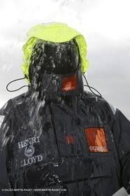 Orange II  - 2005 Jules Verne Trophy - Training in Bay of Biscay - Lionel Lemonchois + helmsan strong wind helmett-